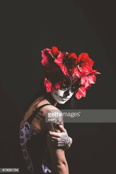 woman wearing day of the dead make up - mexican fiesta stock pictures, royalty-free photos & images