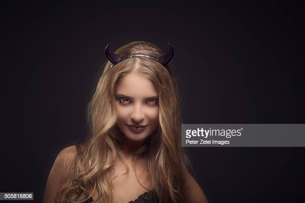 woman wearing devil horns - devil costume stock photos and pictures