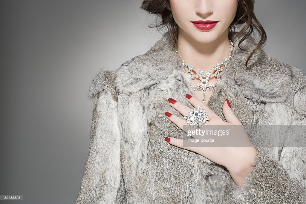 Woman wearing diamonds and a fur coat : Stock Photo