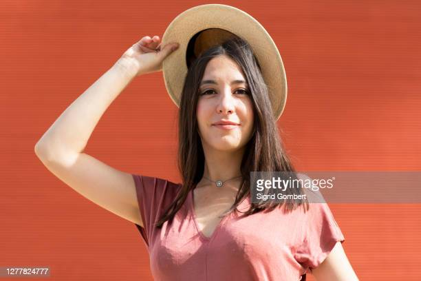 woman wearing dusty pink top and standing outdoors - sigrid gombert stock pictures, royalty-free photos & images