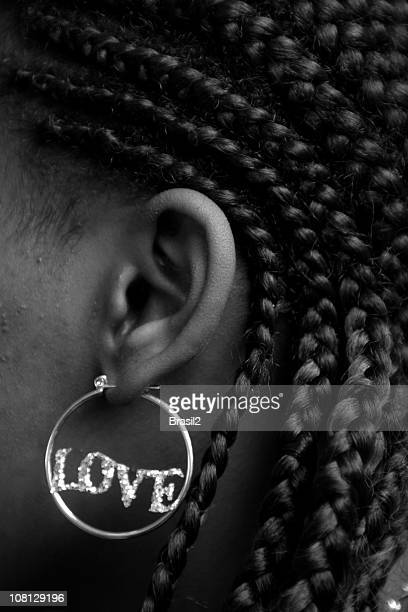 Woman Wearing Earring That Spells 'Love', Black and White