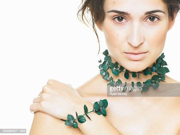 Woman wearing eucalyptus necklace and bracelet, portrait