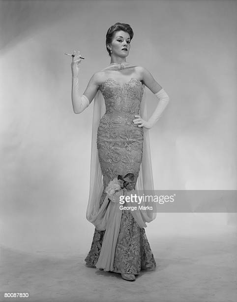 woman wearing evening dress, holding cigarette, portrait - evening glove stock pictures, royalty-free photos & images