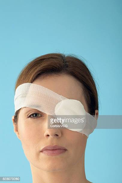 woman wearing eye patch - gauze stock pictures, royalty-free photos & images