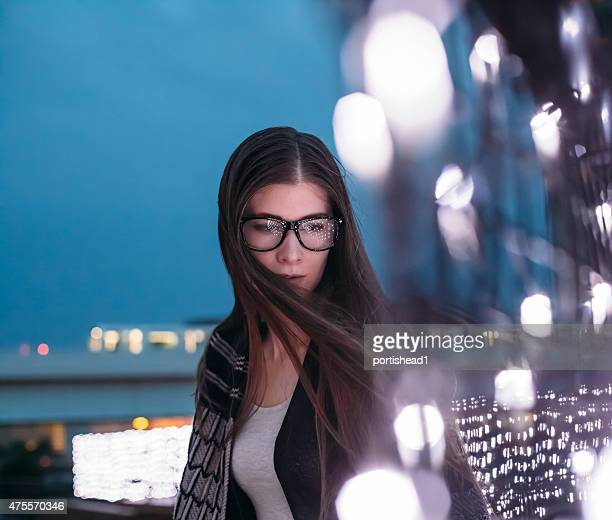 Woman wearing eyeglasses and beautiful bokeh