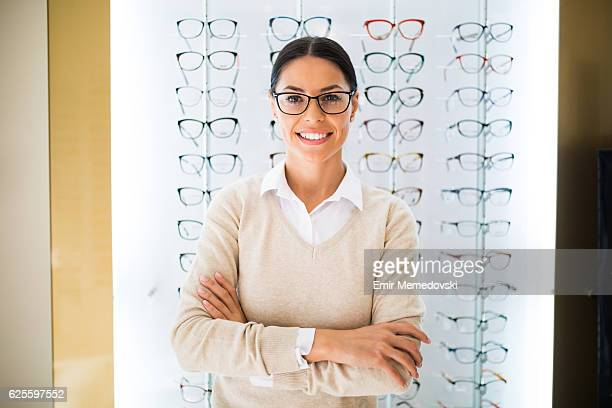 Woman wearing eyeglasses at the optical store