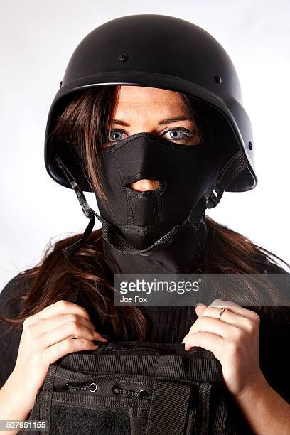 Woman wearing face mask bullet proof jacket