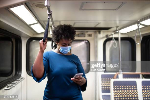woman wearing face mask traveling in a subway - seat stock pictures, royalty-free photos & images