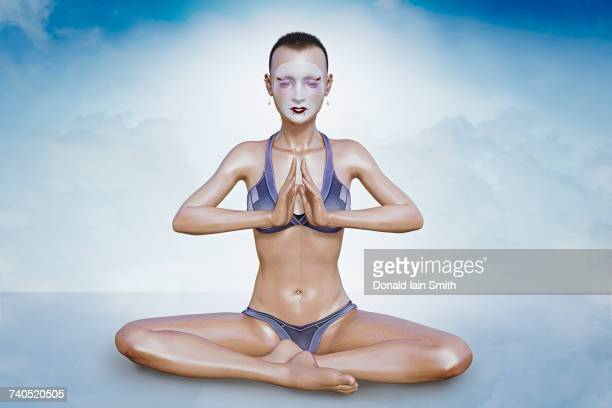 woman wearing face paint meditating - mime stock photos and pictures