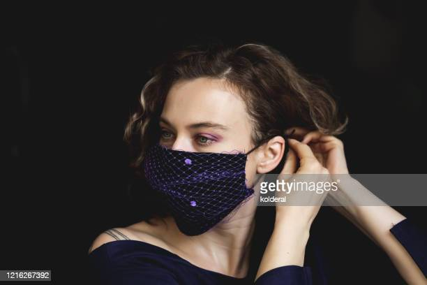 woman wearing fashion protective face mask - pollution mask stock pictures, royalty-free photos & images