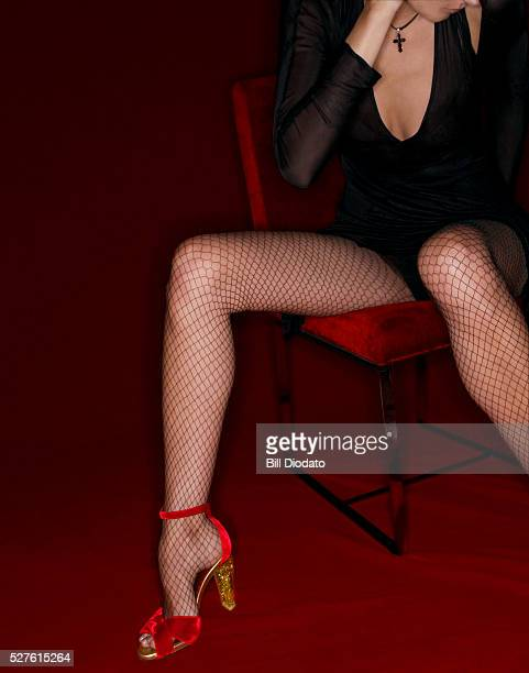 Woman Wearing Fishnets and High Heels