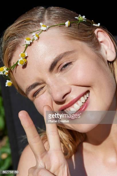 Woman wearing floral garland
