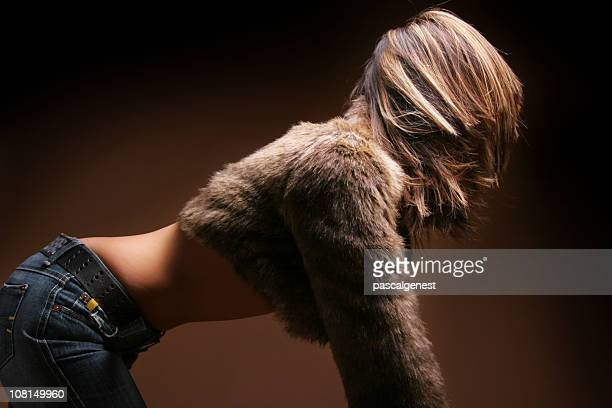 Woman Wearing Fur Coat on all fours