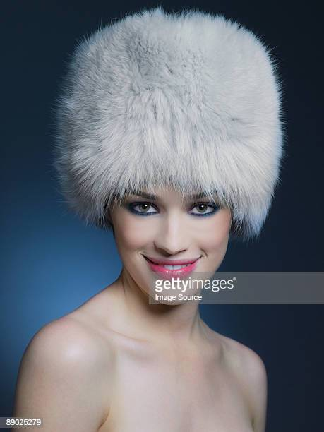 woman wearing fur hat - fur hat stock photos and pictures