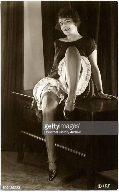 Woman Wearing Garters Nylons Pantaloons Sitting on Cabinet French Postcard circa 1920
