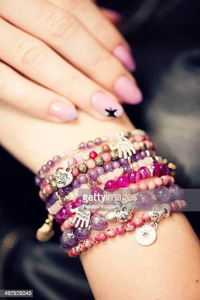 Woman wearing gemstone bracelets.
