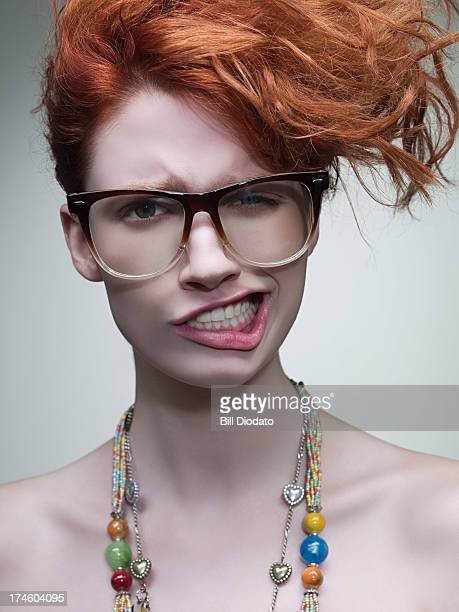 Woman wearing glasses and making faces