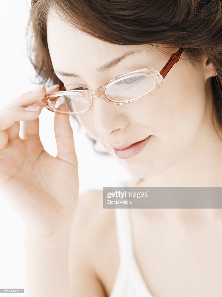 Woman Wearing Glasses Looking Down : Stock Photo