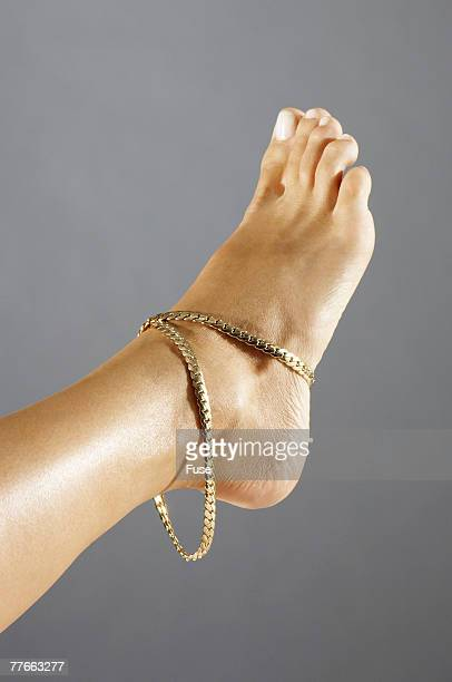 Woman Wearing Gold Anklet