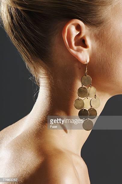 Woman Wearing Gold Earrings