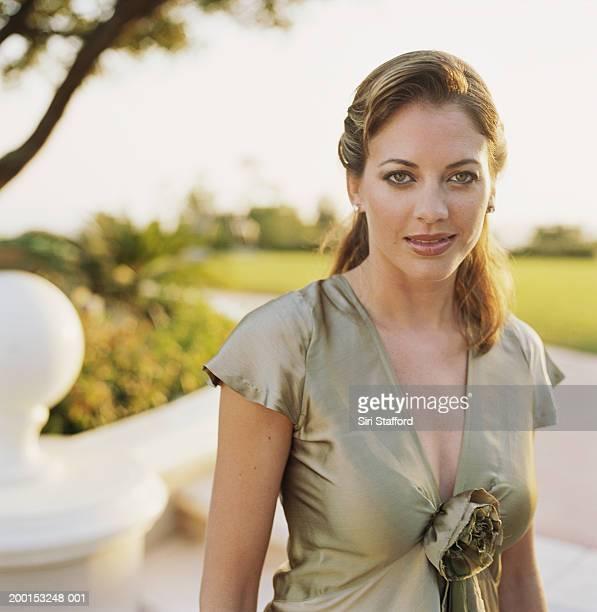 Woman wearing gray blouse, portrait