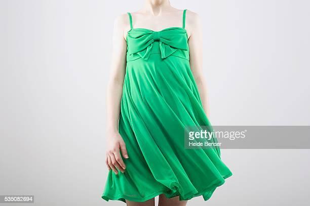 Woman wearing green cocktail dress