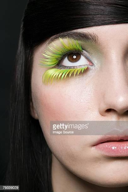 女性まつげを着て、緑色 - つけまつげ ストックフォトと画像