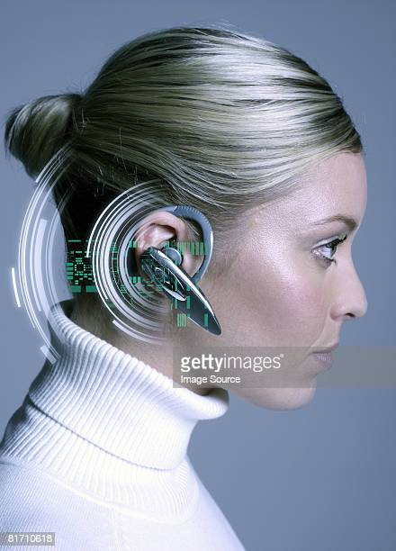 Woman wearing hands free device