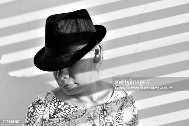 Woman Wearing Hat Against Wall