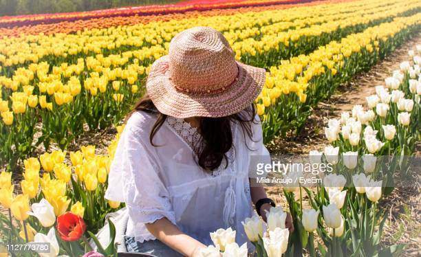 Woman Wearing Hat On Tulip Field