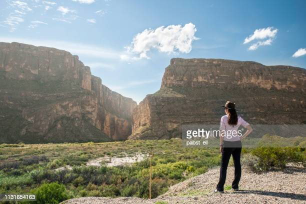 woman wearing hat santa elena canyon big bend - big bend national park stock pictures, royalty-free photos & images