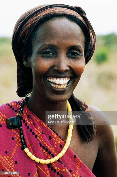 Woman wearing head covering and necklace, Somalia.