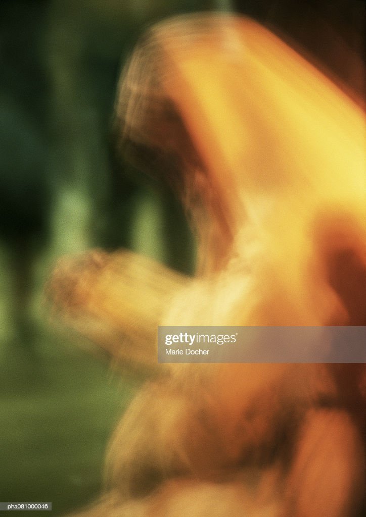 Woman wearing head covering, hands together in prayer, waist up, blurred. : Stockfoto