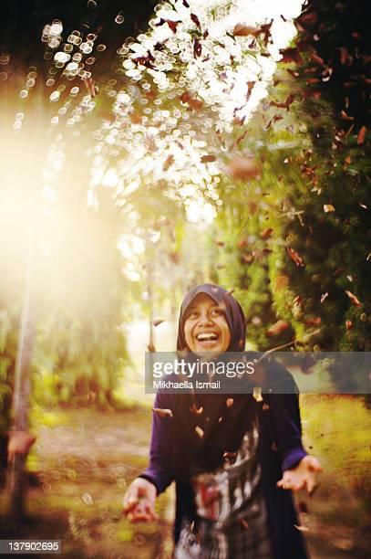 Woman wearing headscarf playing