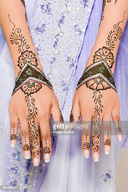 A woman wearing henna tattoos on her hands