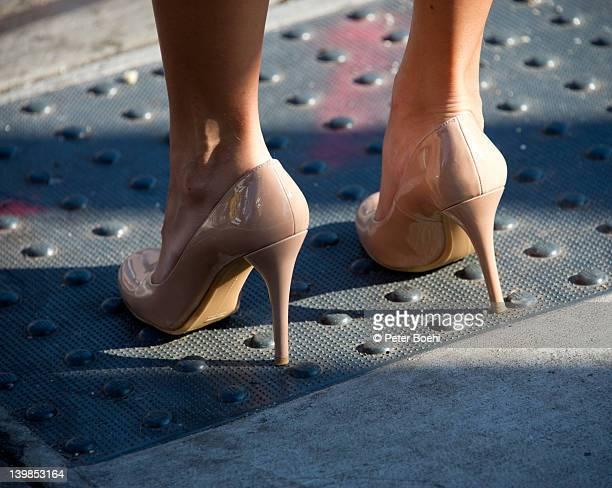 Woman wearing high heel shoes on street