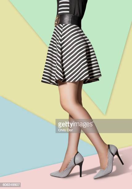 woman wearing high heels and dress - striped dress stock photos and pictures