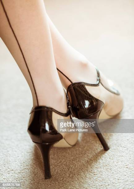 woman wearing high heels and seamed stockings - seamed stockings stock photos and pictures