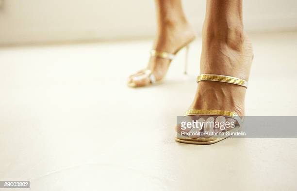Woman wearing high heels, cropped view of feet