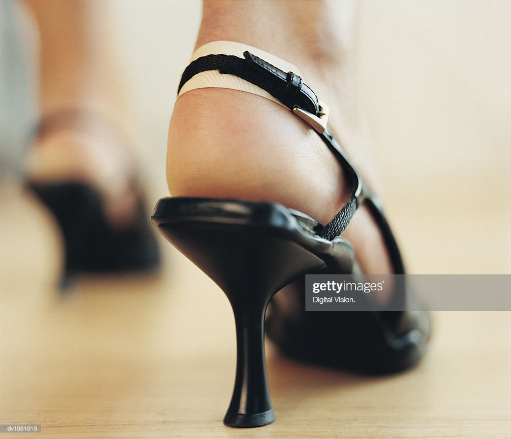 Woman Wearing High Heels on her Blistered Feet : Stock Photo