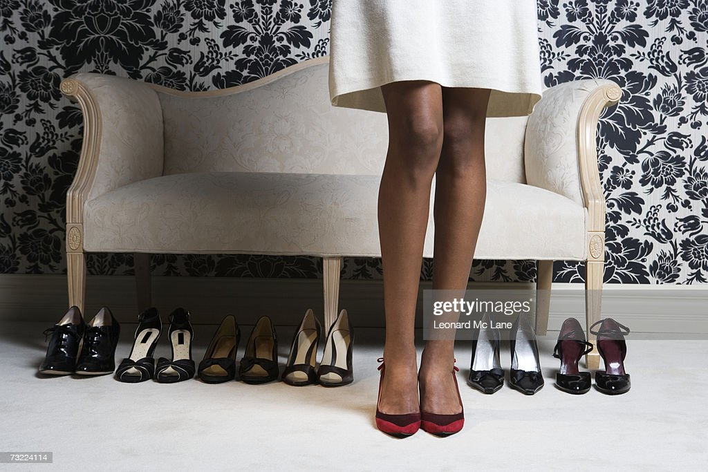 Woman wearing high heels shoes, low section : Stock Photo