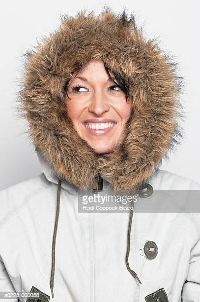 woman wearing hooded jacket - heidi coppock beard stockfoto's en -beelden