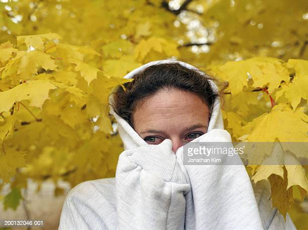 woman wearing hooded sweatshirt, closeup, autumn - hooded shirt stock pictures, royalty-free photos & images