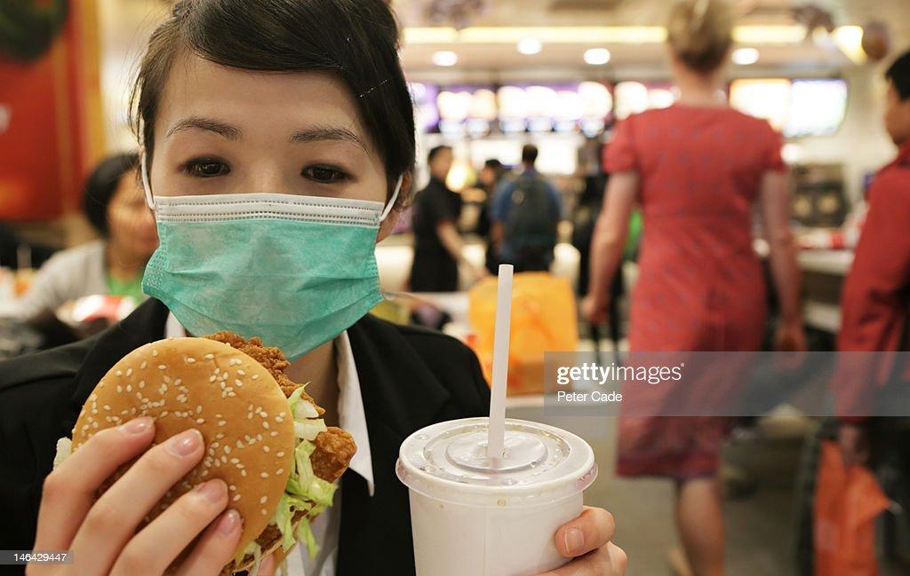 woman wearing hygiene mask in fast food restaurant : Stock Photo