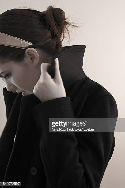 Woman Wearing Jacket While Standing At Home