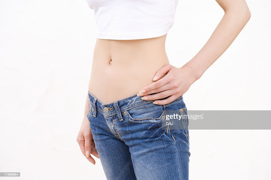 Woman wearing jeans, side view : Photo