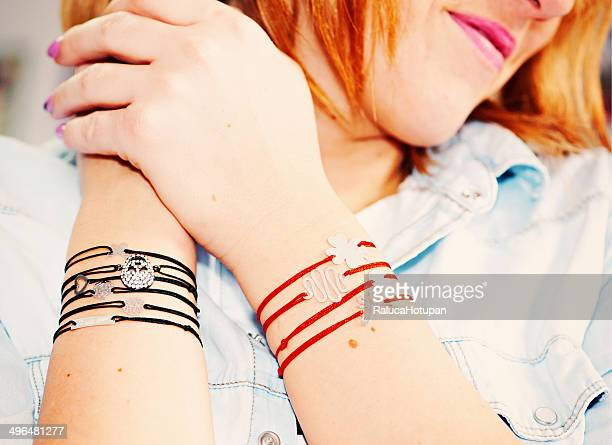 woman wearing jewelery - charm bracelet stock photos and pictures