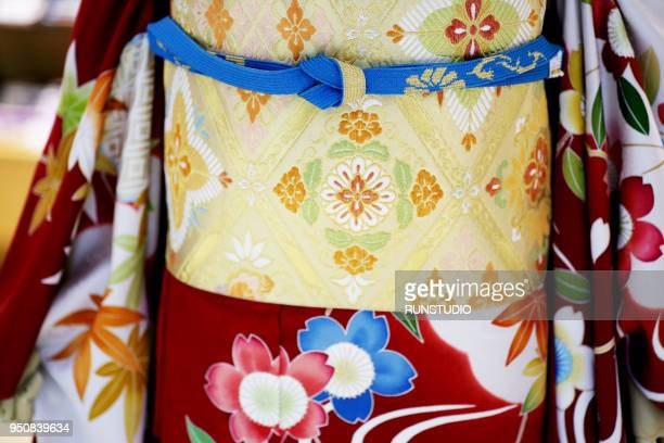 Woman wearing kimono, mid section
