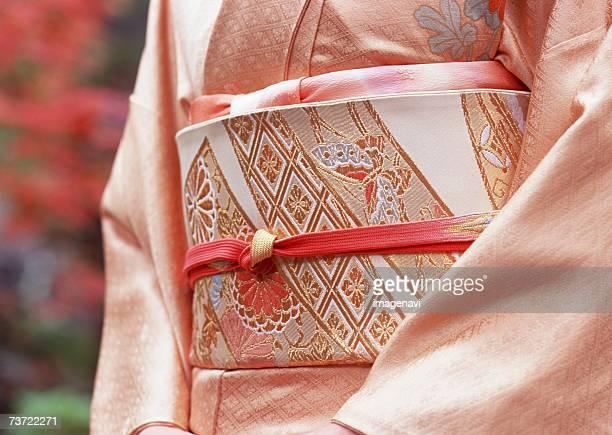 woman wearing kimono - obi sash stock pictures, royalty-free photos & images