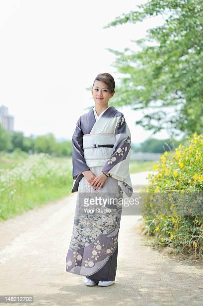 woman wearing kimono,kyoto,japan - kimono stock pictures, royalty-free photos & images
